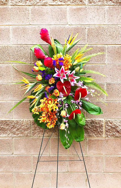 This Beautiful Sympathy Tribute is designed with a bright mix of tropical flowers. Bright colors make a statement in this memorial tribute.