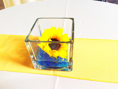 Single sunflowers in a simple square with accent stones