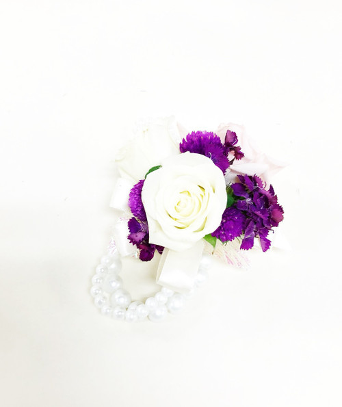 Beautiful and simple fresh flower in ivory and fuchsia wrist corsage on a keepsake bracelet
