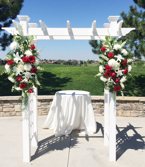 Floral sprays make the perfect accent on your arbor for your ceremony.  These spray are in reds and white including stunning white lilies, red roses and gerberas, complete the arbor for your backdrop.