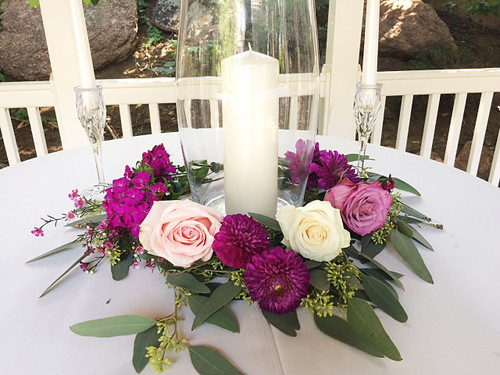 Here's the centerpiece that will make your reception extraordinary!!  Complete with bold roses, dianthus and eucalyptus and will leave your guests speechless.