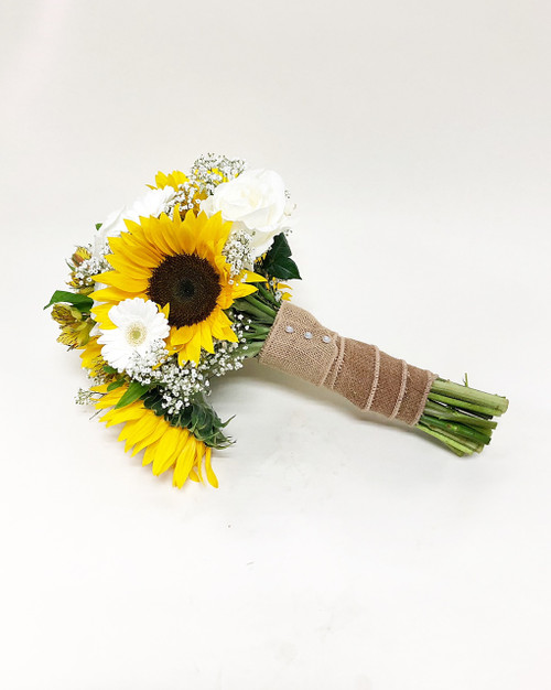 Stunning Hand tied bridal Bouquet designed with local grown fresh cut sunflowers and a mix of white roses and gerberas tied with burlap wrap.