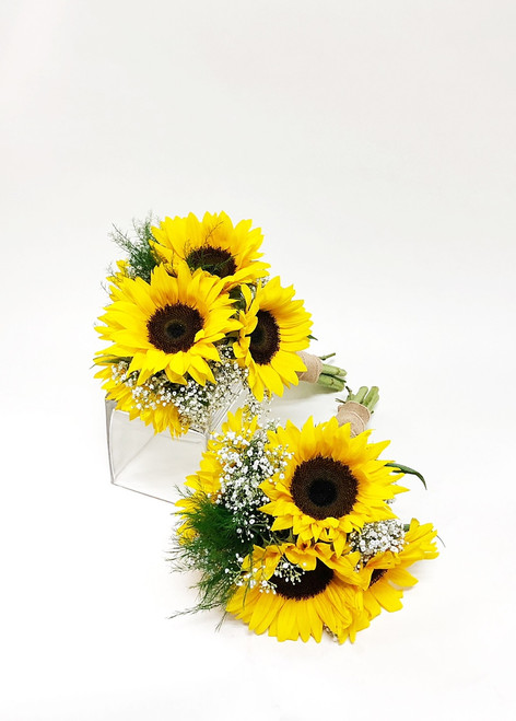 Bold hand-tied bridesmaid bouquet designed with locally  grown fresh cut sunflowers and baby's breath. This design is finished with a burlap wrap in a country chic style.