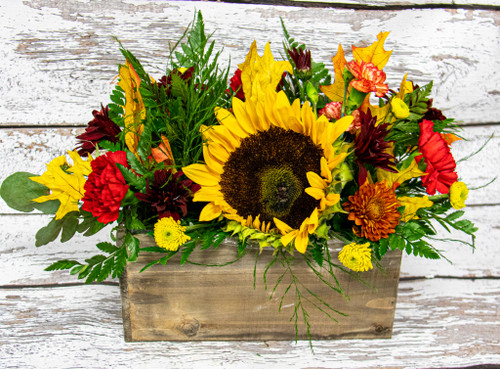 A Bit of Colorado's Beauty designed in a rustic box with fresh flowers local grown sunflowers and all the fall colors! Send it as a centerpiece or a unique fall arrangement!
