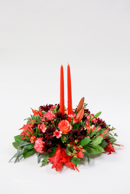 This fall Harvest centerpiece with vibrant colors will be a stunning touch to your dining table!