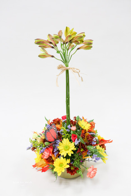 This fall topiary arrangement will remind you of fall and the leaves starting to change colors!