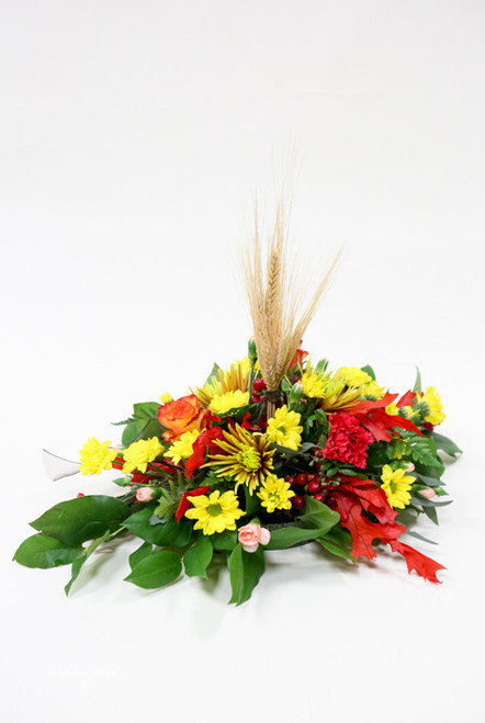 This autumn centerpiece will add beautiful fall colors to your table!