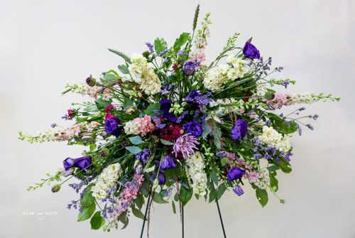A sophisticated of feminine pinks and purples designed in a horizontal easel spray.