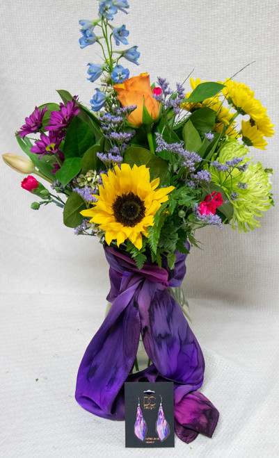 Send mom flowers and gifts this Mother's Day! Start with fun, bright seasonal flowers arranged in a vase. Then, accent it with a hand designed silk scarf from a local artist - Silk Sensations AND an earring set from the local jewelry designers at DC designs!