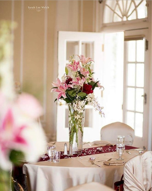 Elegance in pink, white, red, ivory and greens. This Centerpiece is pure beauty with locally grown lilies!