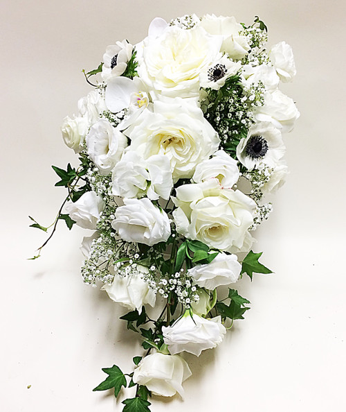 White roses, anemones, lisianthus, and baby's breath, with a hint of ivy in this stunning cascading design.