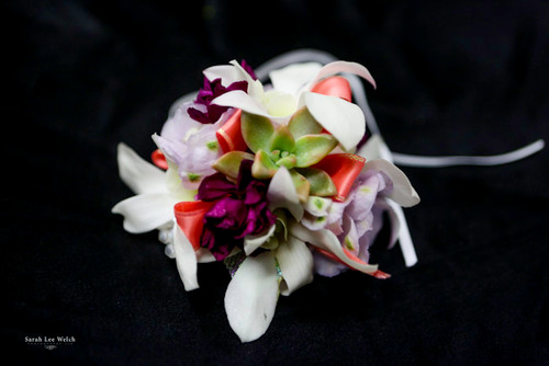 Mixed colors in a variety of soft flowers with a pop of bold succulent.