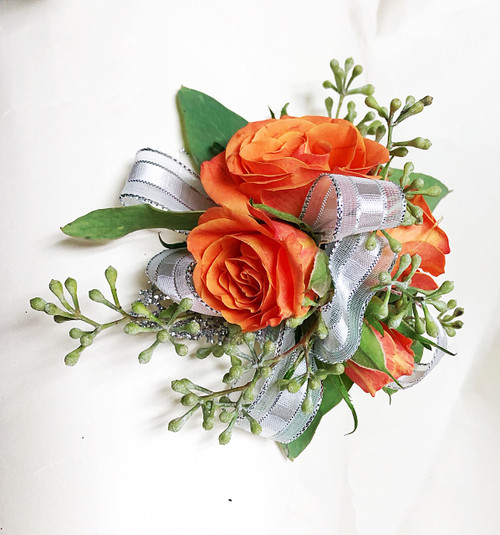 Orange Roses and eucalyptus, a beautiful and simple mixed corsage.