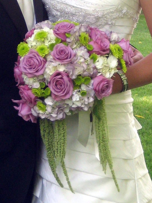 What a beautiful statement this bouquet is with white hydrangea, lavender roses, kermits and  green hanging amaranthus.