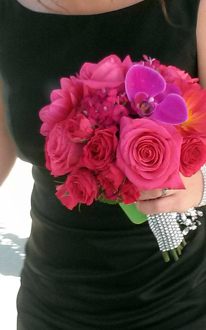 A complement to any bridesmaid, a bold choice of fuchsias and hot pink, with dahlias, roses and orchids.