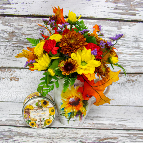 Beautiful sunflower designed mug from Dean Crouser filled with a vibrant fall arrangement with a Michel Designs sunflower candle. Celebrate fall with this fun and vivid arrangement.