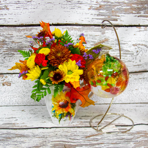 Beautiful sunflower designed mug from Dean Crouser filled with a vibrant fall arrangement with a beautiful hand picked medium sized kitras ball and stand.