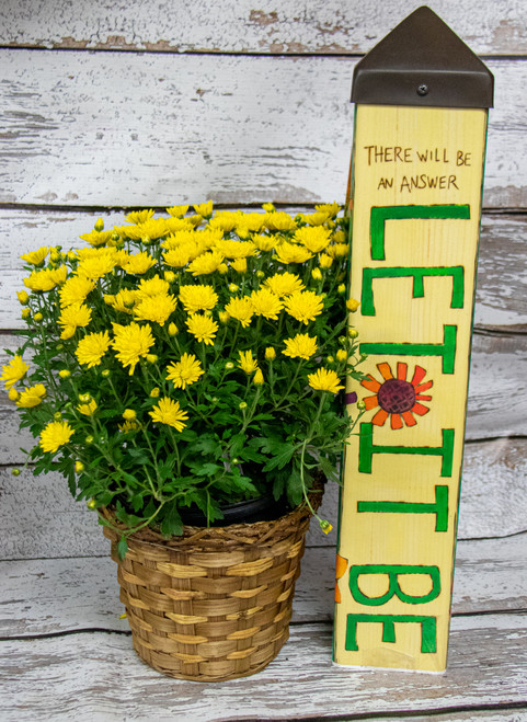 Beautiful fall mums in a woven basket with a small StudioM art pole! StudioM's art poles are made of PVC and covered in vinyl, they are weather resistant and fade resistant, perfect for a cheerful staple in someones yard!