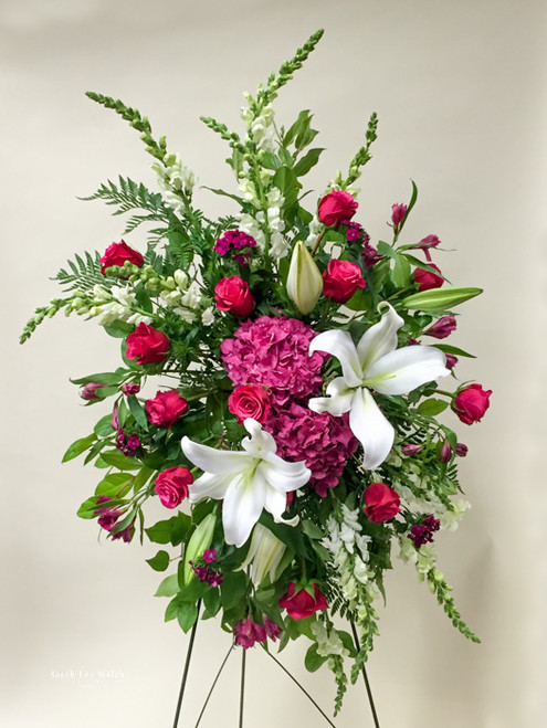 Premium Pink and white Sympathy Spray made with local grown fresh cut white Lilies, Vibrant pink fresh cut long stemmed roses and fresh cut Hydrangea Flowers to accent the arrangement.