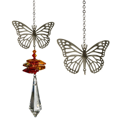 A large crystal is topped by smaller crystals and a silver Monarch butterfly.  Butterflies are a symbol of change and transformation; they serve as a reminder not to be afraid to make changes when an opportunity arises. This butterfly tops a cluster of crystals that sparkle and shine in the sun.  Works equally well as a sun catcher or Christmas ornament. Hang it in your office or dorm room - it's especially beautiful when hanging in the window or in front of a light.  Recommended for indoor use.