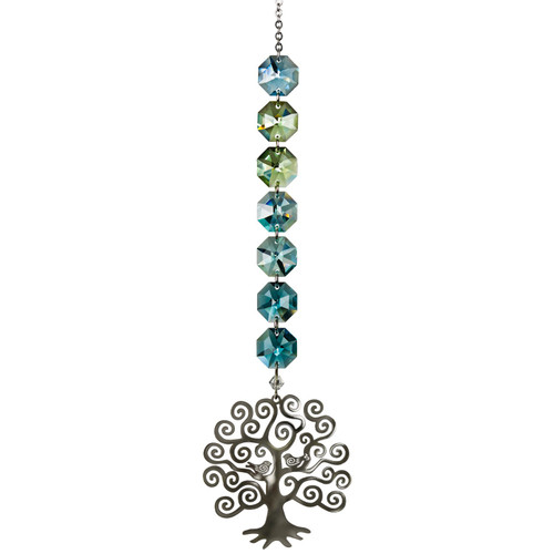 A radiant cascade of seven colored crystals top a silver Tree of Life.  This stylized Tree of Life has two birds nestled in its branches. A wide-ranging symbol, the Tree of Life can represent strength, beauty, bounty and redemption, making it an excellent gift for almost any occasion.  Recommended for indoor use.