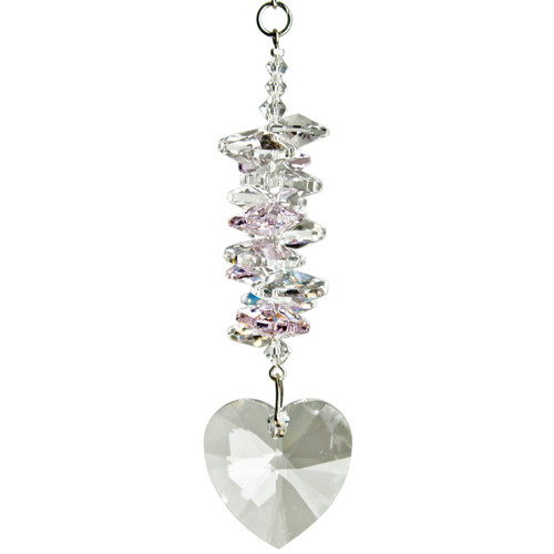 This sweet cluster of clear and pink crystals leads the eye to the jewel-like clear crystal heart drop.  This suncatcher sparkles and shines in the light, spreading rainbows across the wall.  Works equally well as a sun catcher or Christmas ornament. Hang it in your office or dorm room - it's especially beautiful when hanging in the window or in front of a light.  Recommended for indoor use.