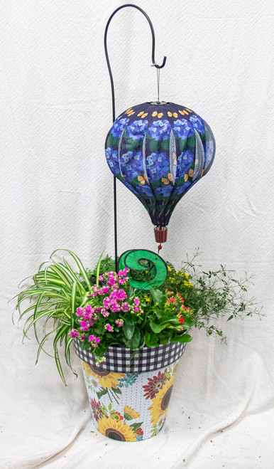 This beautiful large Studio M Art Pot is filled with the highest quality seasonal plants. Adorned with  fun balloon wind spinner. Let us choose a fun pot and balloon to go with the beautiful seasonal pots.