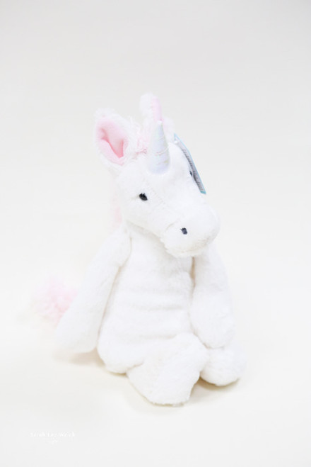 Sugar-sweet in pink and white, Bashful Unicorn is such a delight. Full of magic and moonlight, she loves the forest, so be sure to take her on any picnic. So very cuddly, with squish-squashy hooves, even her horn is shimmery-soft.