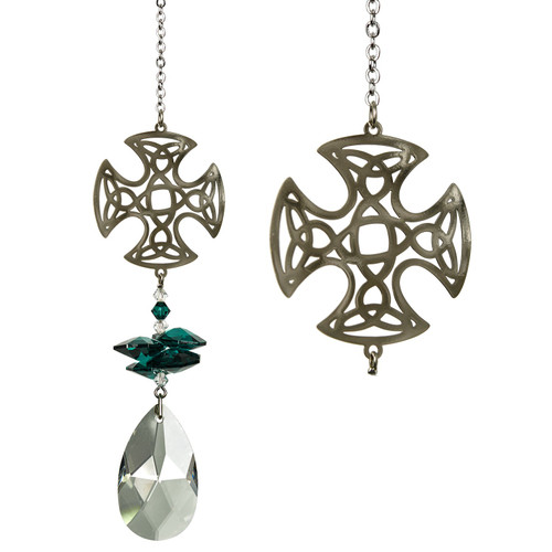 A large crystal drop is topped by smaller emerald green crystals & a silver Celtic Cross.  While the history of this powerful symbol is ambiguous, in our modern multicultural world its is as much a symbol of ethnic heritage as it is of faith and it is often used as an emblem of Irish, Scottish or Welsh identity. This Celtic Cross tops a cluster of crystals that sparkle and shine in the sun.  Works equally well as a sun catcher or Christmas ornament. Hang it in your office or dorm room - it's especially beautiful when hanging in the window or in front of a light.  Recommended for indoor use.