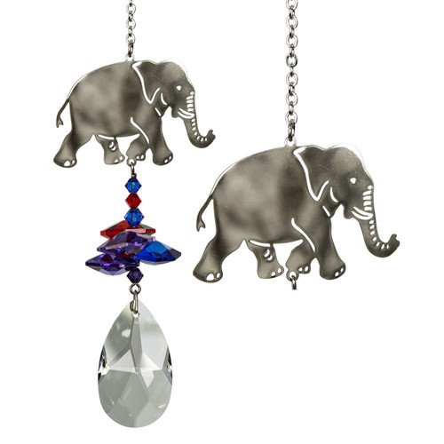 A large crystal is topped by smaller crystals and a happy silver elephant.  Elephants are considered a symbol of good luck, power, success, wisdom and experience. Because elephants are highly social animals, they also represent loyalty, companionship and unity.  This handsome elephant tops a cluster of crystals that sparkle and shine in the sun.  Works equally well as a sun catcher or Christmas ornament. Hang it in your office or dorm room - it's especially beautiful when hanging in the window or in front of a light.  Recommended for indoor use.