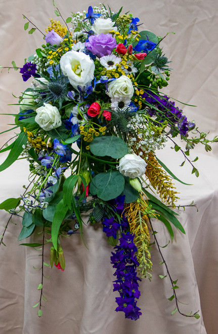 A cascading bridal bouquet with all kinds of different wildflowers in all sorts of colors, it is like we picked the flowers right off the mountain!