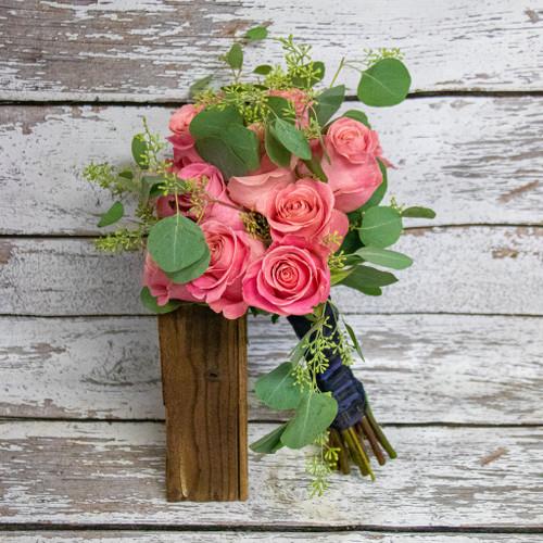 A simple dozen dusty rose colored nosegay bouquet.