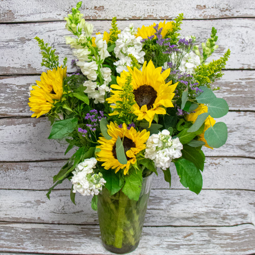 Beautiful sunflowers in a stunning large arrangement accented by fresh flowers!