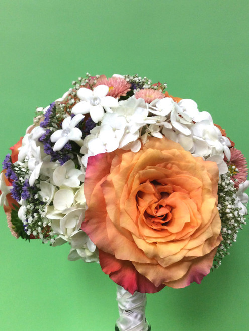 Wow what a rose!  Looks prefect with mix of  baby's breathe, hydrangea, asters and stephanotis.