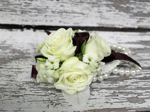 White and Maroon Corsage on Pearl Bracelet