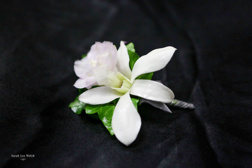 White Orchid with a Touch of Lavender Boutonniere