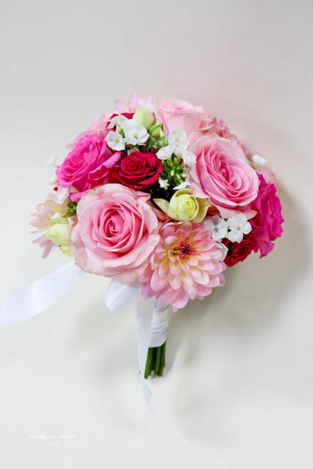 Here's are wonderful summer mix bouquet in shades of pinks and greens.  With roses, dahlias, gerberas and berries.