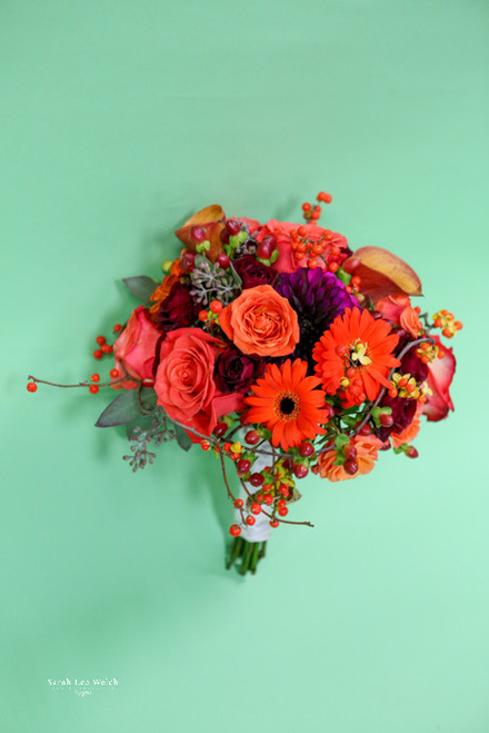 Awesome fall bouquet in oranges with gerberas, roses, dahlias, mini calla lilies and wonderful very cool bittersweet, adding the perfect fall touch.