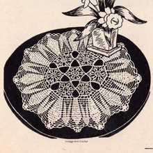 Crocheted Flower Medallion Doily Pattern is 12 inches