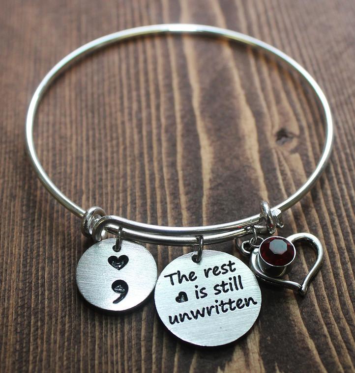 """The rest is still unwritten"" Semi Colon Bangle Bracelet"
