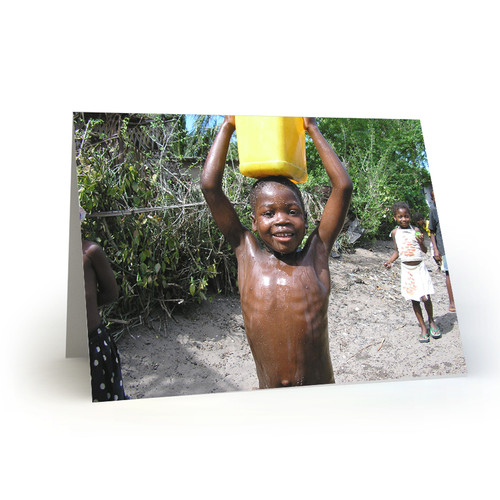 Young Boy Carries Water in Mozambique