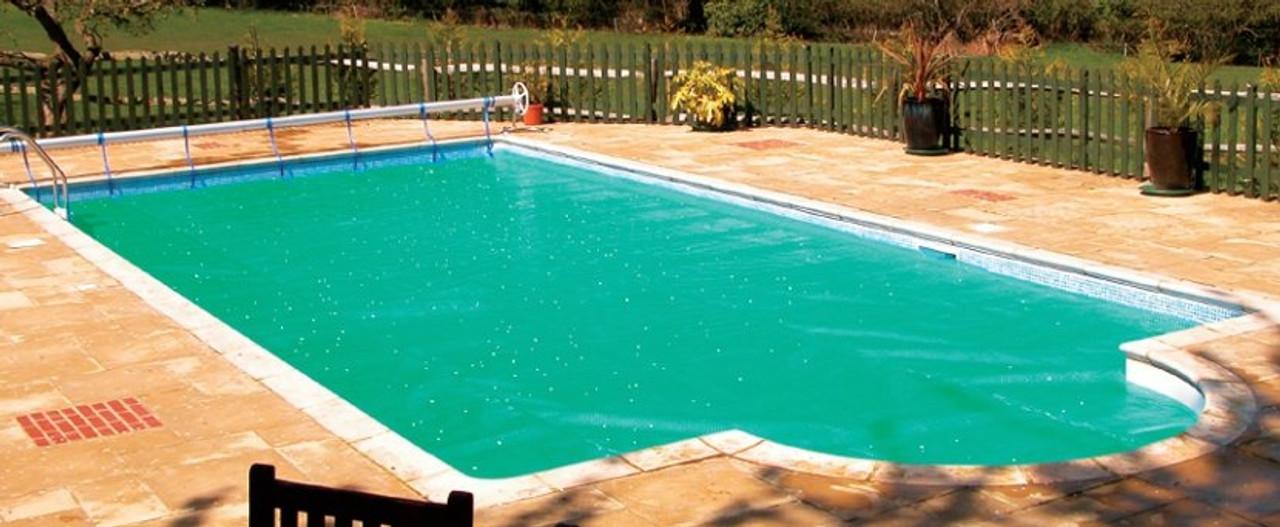 GeoBubble Midas 500 swimming pool solar cover Gold on pool