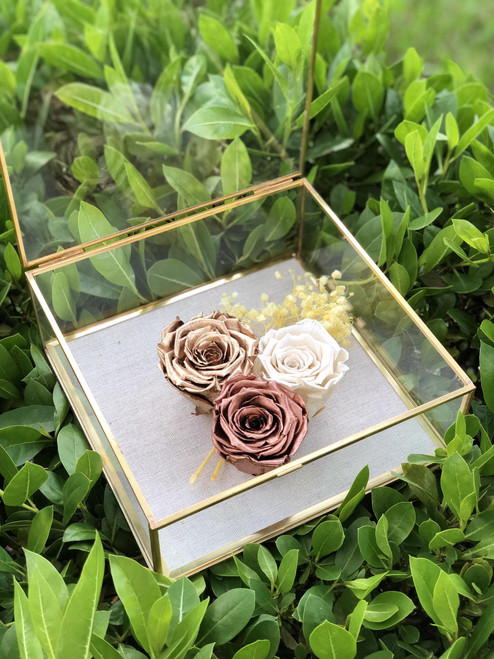 Metallic roses in a Brass Box