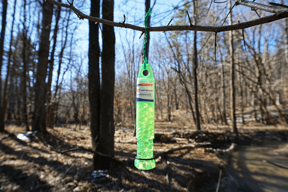 Dispenser of DIRT hanging in the woods. Scentballz Scents PAY DIRT in an Everscent Twist Dispenser. For spring turkey hunters trying to seal the deal on that pesky gobbler.