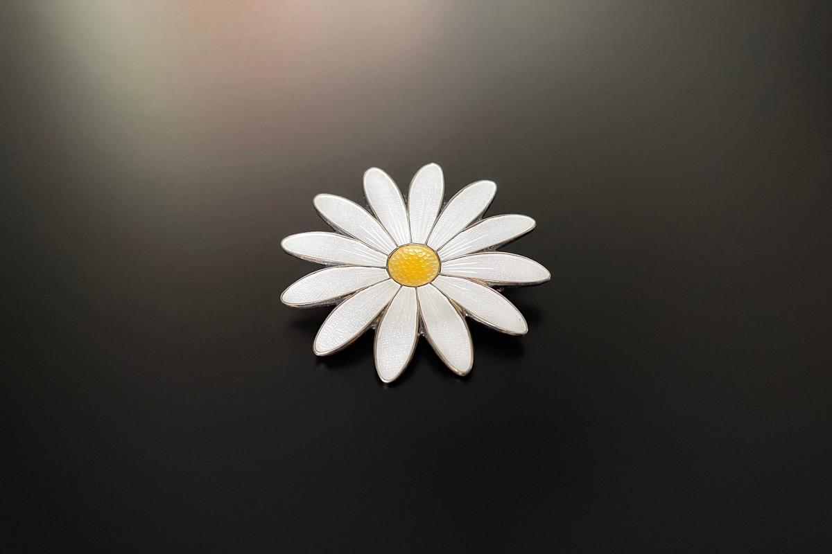 A Divine Norwegian Enamel and Sterling Silver Gilt Brooch Modelled as a daisy White enamel petals and yellow stamen Sterling silver gilt