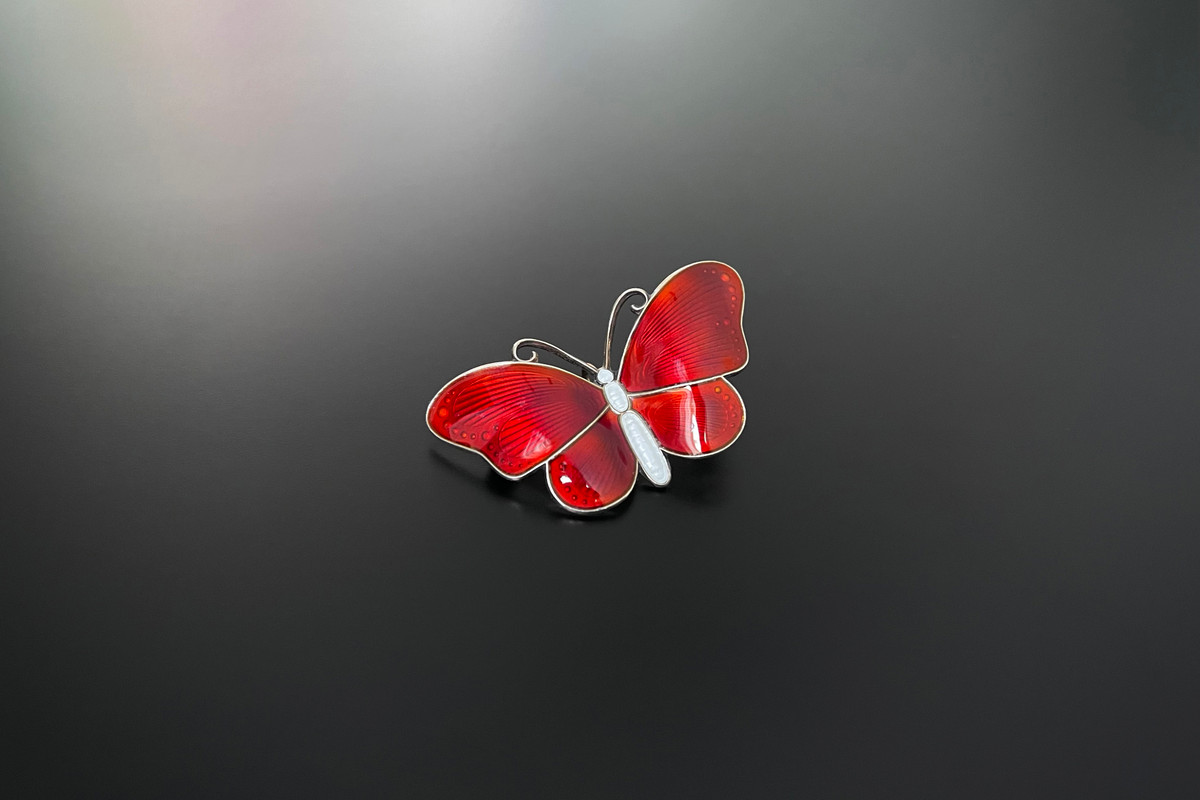 A Beautiful Norwegian Enamel and Sterling Silver Gilt Brooch Modelled as a butterfly Red enamel wings and white enamel body Sterling silver gilt