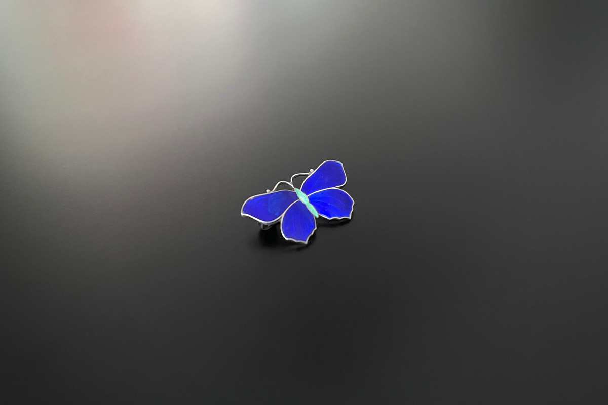 A Pretty Norwegian Enamel and Sterling Silver Brooch Modelled as a butterfly  Royal blue enamel wings and pale green body Sterling silver gilt Dimensions: 32mm x 18mm