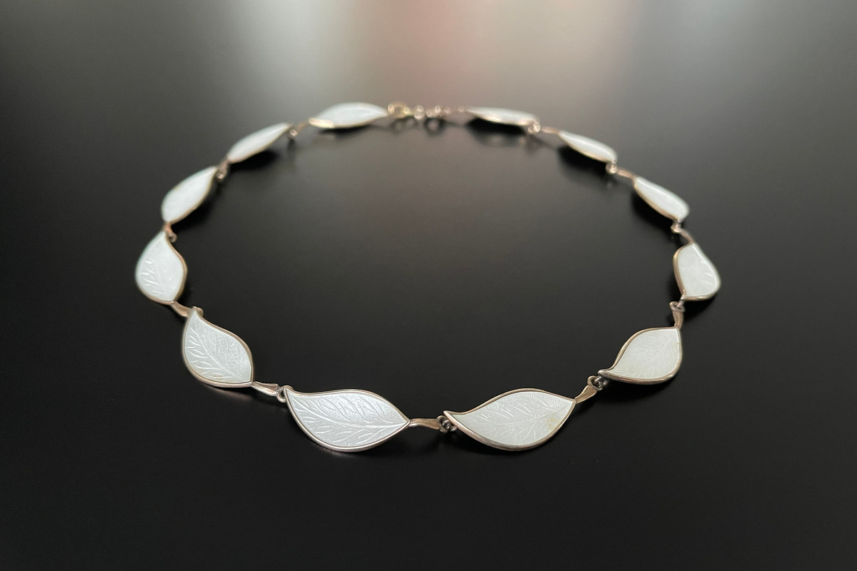 A Fabulous Norwegian Enamel and Sterling Silver Gilt Necklace Modelled as leaves in white enamel Sterling silver gilt Total length: 420mm