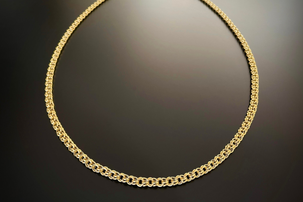 A Superb Long Gold Chain Hollow and reeded belcher link design  18ct yellow gold Total weight: 53.2gms Total length: 1180mm