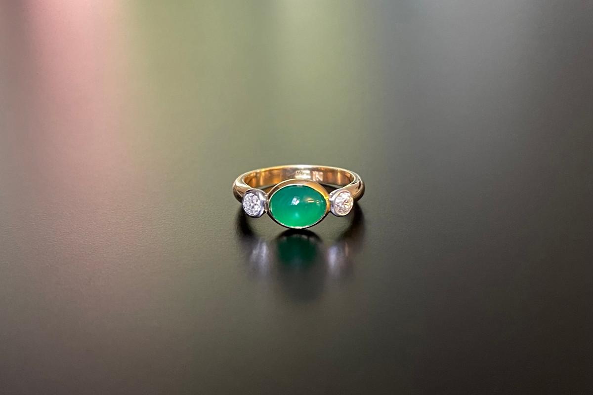 A Kozminsky Cabochon Emerald and Diamond Ring